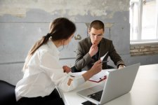 female-estate-agent-showing-new-home-young-man-after-discussion-house-plans-moving-new-home-co...jpg