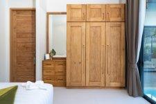 spacious-modern-bedroom-with-wooden-wardrobe.jpg